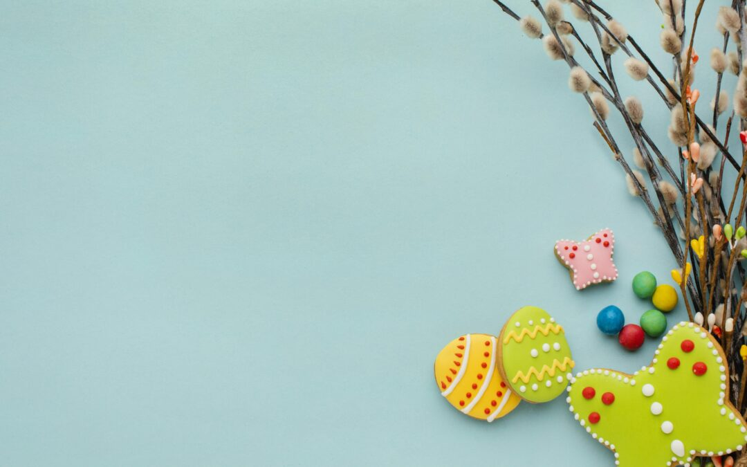 top-view-of-colorful-easter-eggs-with-twigs-and-copy-space
